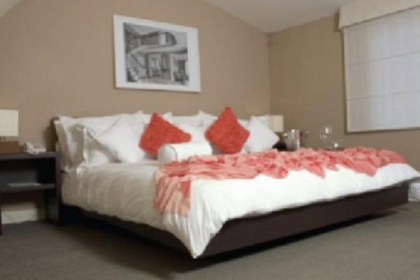 Habitación. Fuente: hotelboutiquealma.com